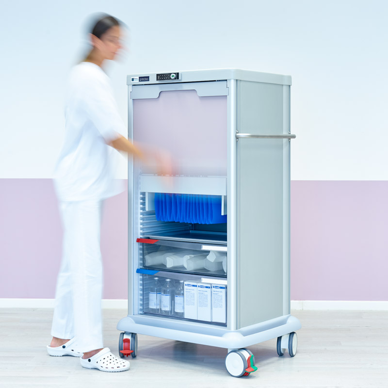 A PRECISO TRS140 transport column: a nurse opens the rolling shutter and transparent drawers are visible