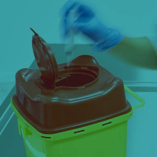 Supporto per contenitori rifiuti taglienti